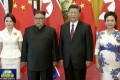 North Korean leader King Jong-un (second left) returned to Beijing for his third visit in three months on Tuesday. He is pictured with (from left) his wife, Ri Sol-ju, Chinese President Xi Jinping and Peng Liyuan. Photo: AP
