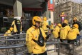 Delivery drivers of Meituan Takeaway wait for orders. Photo: SCMP