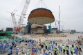 A dome is installed at the No 5 unit of the CNNC Fuqing nuclear power plant in Fujian province last year. The industry is said to lack workers in power plant design and engineering construction, among other areas. Photo: Xinhua