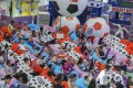 Soccer fans watch a live broadcast of the opening game of the Fifa World Cup, at East Point City in Tseung Kwan O on June 14. Photo: K.Y. Cheng
