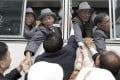 North Koreans in a bus bid farewell to their South Korean relatives before they return to their home towns after the 11th Separated Family Reunion Meeting at Diamond Mountain in North Korea. Photo: AP