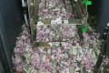 Shredded 2,000 and 500 rupee notes in the cash machine in Tinsukia in India's northeastern Assam state. Photo: AFP