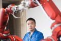 "A technician from Rui'an Hsoar Group debugs a robot in Rui'an City in China's Zhejiang province. China has set ambitious technological targets as part of its ""Made in China 2025"" campaign, but this has led to allegations of unfair competition at home, theft of intellectual property and strong-arming foreign companies in China into sharing knowledge with Chinese entities. Photo: Xinhua"