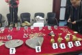 Some of the rare artefacts recovered by police, which were stolen during the raid on the tomb. Photo: CNA