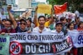 Vietnamese protesters shout slogans against a proposal to grant foreign companies lengthy land leases during a demonstration in Ho Chi Minh City on June 10, 2018. Photo: AFP