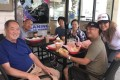 Ted Ngoy with relatives at a fast-food restaurant in Orange County. He came back to the United States to publicise his autobiography to the Cambodian community in California. Photo: Ted Ngoy