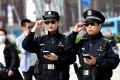 Police officers display their AI-powered smart glasses in Luoyang, Henan province, China. Photo: Reuters