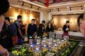 Visitors look at a model of residential buildings in Dandong New Zone, at a showroom in Dandong, Liaoning province on May 6, 2018. Photo: REUTERS