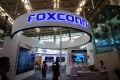Visitors are seen at a Foxconn booth at the World Intelligence Congress in Tianjin, China May, 2018. Photo: Reuters
