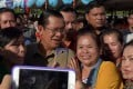 Hun Sen poses for photos with Cambodians as he opened the first major zoo in the capital, Phnom Penh. Photo: AFP