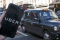 The Uber app on a mobile phone in central London. Westminster Magistrates' Court in London has ruled Uber is to receive a 15-month license for operating in London. Photo: EPA