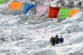 In this photograph taken on April 24, 2018, an unidentified injured person is carried by others at the Everest Base Camp near Namche Bazar. Photo: Agence France-Presse