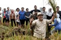 Regi Wahyu, the CEO of HARA, with farmers in Indonesia. HARA is a data exchange platform that is geared towards small farmers. Photo: HARA