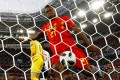 Michy Batshuayi kicks the ball in celebration after teammate Adnan Januzaj scores Belgium's goal, but he gets a nasty surprise. Photo: Reuters