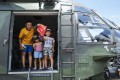 Visitors aboard a PLA helicopter at Shek Kong in the New Territories. Photo: Winson Wong