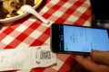 A customer uses WeChat Pay to pay the bill inside a restaurant in China. Photo: Reuters