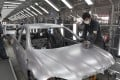 Production line workers build BMW cars at Brilliance Automotive, Shenyang City, Liaoning Province, in China in 2009. Photo: EPA