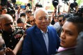 Najib Razak arrives at the Malaysian Anti-Corruption Commission for questioning last month. So far, there have been no public images of his arrest. Photo: AFP