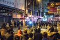 Violence broke out after a hawker control operation in one of the city's most popular shopping districts turned ugly. Photo: AFP