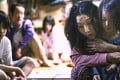 Sakura Ando (second from right), Miyu Sasaki (far right) and Kairi Jyo (left) in a still from Shoplifters (category IIB; Japanese), directed by Hirokazu Koreeda . Lily Franky and Kirin Kiki co-star.