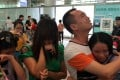 Chinese-American Kylee Bowers (right) is reunited with her biological family in Guangzhou on Sunday. Photo: Weibo
