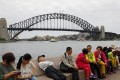 Chinese tourists near the Harbour Bridge in Sydney. Picture: Reuters