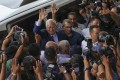 Former Malaysian prime minister Najib Razak waves to supporters as he leaves the Kuala Lumpur High Court. Photo: AFP