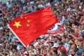 A fan waves the China flag during the Fifa World Cup 2018 group E match between Costa Rica and Serbia. Photo: EPA