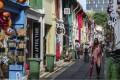 Tourists walking on Haji Lane in the Kampong Glam neighbourhood in Singapore. Photo: Roy Issa