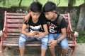 A pair of teenagers with smartphones. Southeast Asia's diversity and population has made it both an attractive and difficult target to crack. Photo: Washington Post