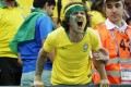 A Brazilian supporter reacts in anger after the World Cup 2018 quarter-final loss to Belgium. Photo: EPA