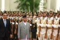 Nepalese Prime Minister K P Sharma Oli (centre) and Chinese Premier Li Keqiang review a military guard of honour during a welcome ceremony at the Great Hall of the People in Beijing on June 21. Nepal and China signed eight agreements during the visit. Photo: AFP