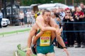 Vytautas Kirkliauskas of Lithuania carries his wife Neringa Kirkliauskiene as they compete during the Wife Carrying World Championships 2018 in Sonkajarvi, Finland. Photo: Reuters