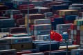 Containers at the Yangshan deep water port in Shanghai. The first shots in a trade war between the US and China have been fired with tit-for-tat tariffs announced on July 6. Photo: AFP