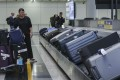 """""""The objective of this new arrangement is to ensure sufficient manpower at each of the baggage reclaim belts, so that bags could be delivered efficiently to passengers,"""" an Airport Authority spokeswoman said. Photo: Roy Issa"""