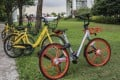 Bikes from Ofo (rear) and Mobike (front) seen in Singapore. Photo: SCMP/Roy Issa