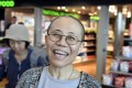 Liu Xia, the widow of Chinese Nobel Peace Prize-winning political dissident Liu Xiaobo, smiles as she arrives at the Helsinki International Airport in Vantaa, Finland on Tuesday. Photo: Reuters