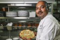 Chef Palash Mitra shows off his naan. Photo: Xiaomei Chen