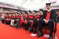 Chinese basketball legend Yao Ming attends the graduation ceremony after earning his degree in economics from Shanghai University. Photo: Twitter