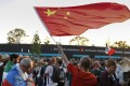 A Chinese fan waves the national flag after the World Cup 2018 match between Germany and Mexico. Photo: AP