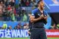 France midfielder Corentin Tolisso celebrates the team's semi-final victory against Belgium at the St Petersburg Stadium, where Wanda's branding features on the advertising hoardings. Photo: AFP