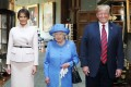 Queen Elizabeth II with US President Donald Trump and first lady Melania Trump in the Grand Corridor of Windsor Castle on Friday. Photo: EPA-EFE