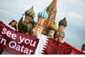 A group of people display a banner reading 'See you in Qatar' in reference to the Qatar 2022 World Cup at Red Square in Moscow. Photo: AFP
