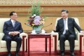 Chinese President Xi Jinping (right) meets a delegation of people from various sectors in Taiwan, led by former chairman of the Kuomintang party Lien Chan (left), at the Great Hall of the People in Beijing on Friday. Photo: Xinhua