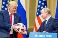 US President Donald Trump is passed a football by Russian leader Vladimir Putin. Photo: EPA