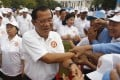 Cambodian Prime Minister Hun Sen greets supporters at a campaign rally on July 7. His Cambodian People's Party is expected to sweep the polls after the government dissolved the main opposition party. The Cambodian strongman is at the peak of a reign that began in 1985. Photo: AP