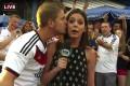A German fan plants a kiss on Fox Sports' Katie Nolan after Germany's win aver Algeria in New York in June. Photo: Fox Sports via YouTube