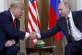 US President Donald Trump and Russian President Vladimir Putin shake hands on Monday. Trump has invited Putin to join him in the US, in a move that has startled the US president's own staff. Phtoo: AP