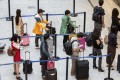 Chinese travellers are forecast to make more than 200 million outbound trips annually by 2020, up from about 130 million outbound trips last year, according to estimates from the China National Tourism Administration. Photo: Bloomberg