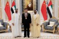 Xi Jinping flanked by Sheikh Mohamed bin Zayed Al Nahyan Crown Prince of Abu Dhabi, left, and Sheikh Mohammed bin Rashid Al Maktoum, ruler of Dubai and Prime Minister of the UAE. Photo: EPA-EFE/Emirates News Agency
